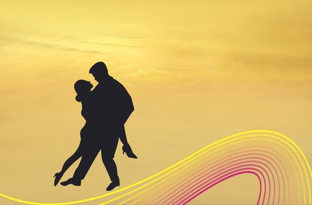 Silhouette of couple dancing the Tango photo