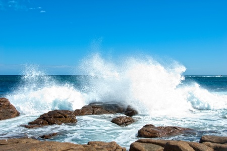 Waves crashing onto coastal rocks Stock Photo