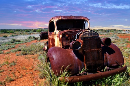 antique: A rusty old pick-up truck sits derelict in a field