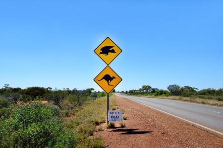 Australian Kangaroo & Eagle warning sign on the side of a road in Western Australia photo