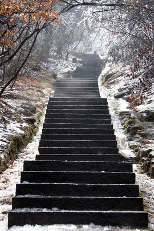Stairway Leading Upwards in the Snow Stock Photo