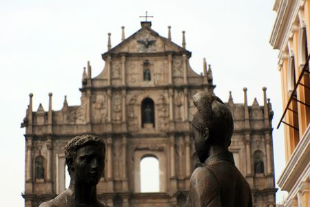 Satue in Front of Ruins of St Pauls Cathedral, Macau photo