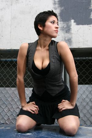 dark haired woman: Fashion Model in Ghetto Setting