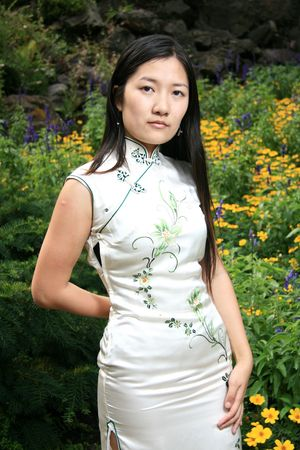 Portrait of Traditional Chinese Girl in an Authentic Chinese Dress photo
