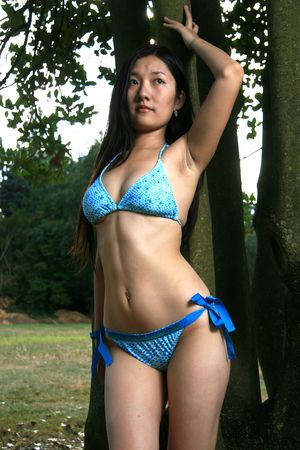 Asian Bikini Model Posing Outdoors photo
