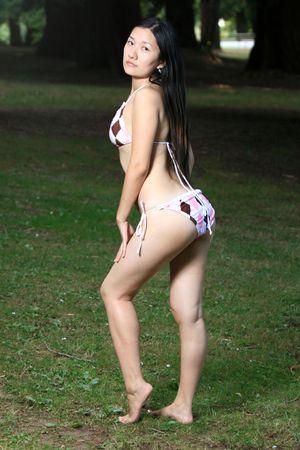 Asian Bikini Model Posing Outdoors photo