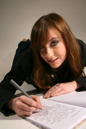 Attractive Young Caucasian Woman with Brown Hair Studying  Writing a Letter photo