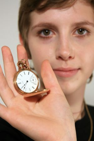 admiring: Girl Holding Old Fashioned Pocket Watch Stock Photo