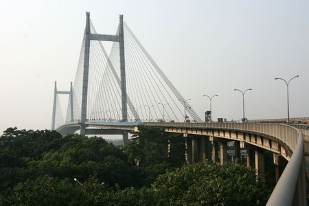 calcutta: Hooghly Bridge, a famous landmrk in the city of Calcutta  Kolkata, India