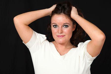 hoer: Mooie Young Woman op geïsoleerde zwarte achtergrond Stockfoto