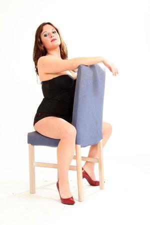 hoer: Mooie jonge vrouw op geïsoleerde zwarte achtergrond Stockfoto