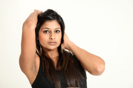 Beautiful Young Indian Woman in Isolated Studio Setting Stock Photo