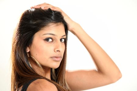 Beautiful Young Indian Woman in Isolated Studio Setting Stock Photo - 4823256