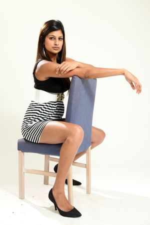 indian style sitting: Beautiful Young Indian Woman in Isolated Studio Setting Stock Photo