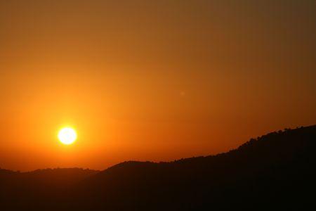 Sun Setting over Serengeti Wildlife Conservation Area, Safari, Tanzania, East Africa photo
