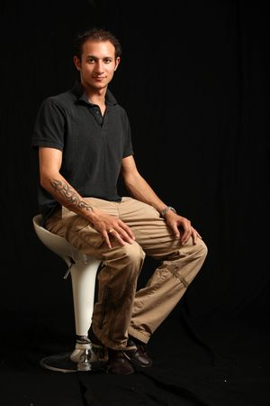 Good Looking Handsome Young Man in a Studio Setting photo
