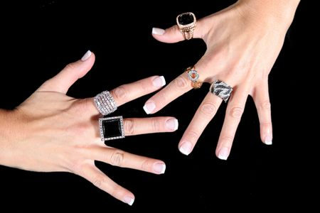 Womens Hands Wearing Expensive Luxury Rings  photo