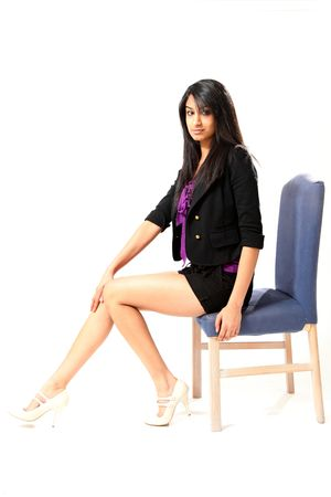 indian style sitting: Beautiful Young Female Model in Isolated Studio Setting