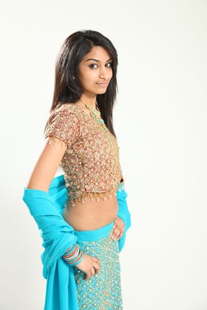 Beautiful Young Indian Female Model in Isolated Studio Setting photo