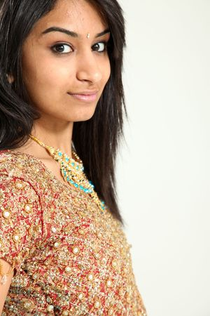 traditional clothes: Beautiful Young Indian Female Model in Isolated Studio Setting