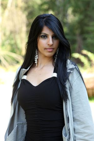 Cute Young Indian Model In An Outdoors Setting photo