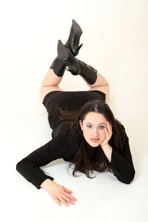 sprawled: Beautiful Young Female Model in Isolated Studio Setting