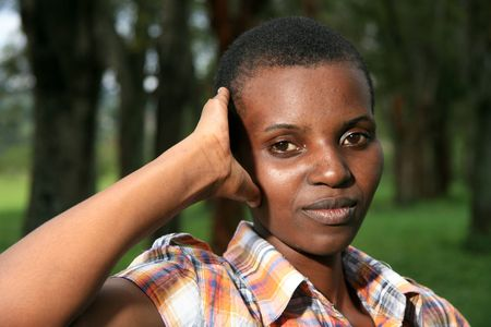 african woman face: Beautiful Young African Lady in Natural Setting