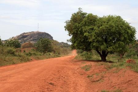 unsurfaced road: Abela Rock in Katakwi, Uganda - The Pearl of Africa Stock Photo
