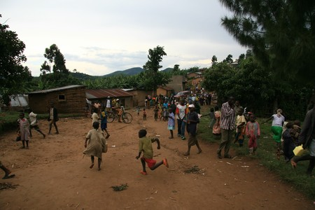 kisoro: DR CONGO - NOV 2ND : Refugees cross from DR Congo into Uganda at the border village of Busanza in Kisoro district on 2nd November 2008