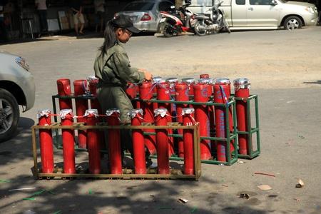adulyadej: BANGKOK - DEC 5: Workers prepare fireworks for the Kings Birthday Celebration - Bangkok, Thailand 5th December 2010)