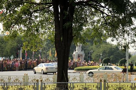 adulyadej: BANGKOK - DEC 5: King Arrives for his Birthday Celebration near the Grand Palace - Bangkok, Thailand 5th December 2010) Editorial