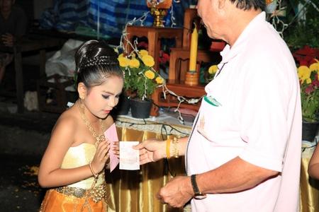adulyadej: BANGKOK - DEC 5: Authentic Dressed Thai Girls Traditional Dance Show for Kings Birthday Celebration - Bangkok, Thailand 5th December 2010) Editorial
