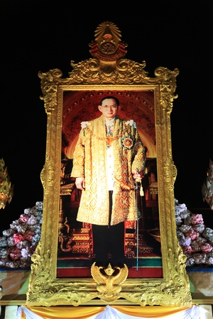 adulyadej: BANGKOK - DEC 5: Portrait Display of King Rama IX for his Birthday Celebration - Bangkok, Thailand 5th December 2010) Editorial