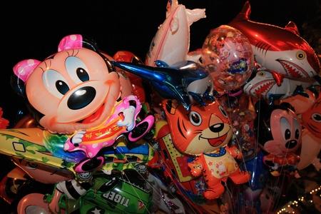 the novelty: BANGKOK - DEC 5: People buy Novelty Balloons at the Kings Birthday Celebration - Bangkok, Thailand 5th December 2010)