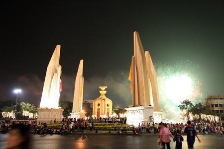 adulyadej: BANGKOK - DEC 5: Fireworks behind the Democracy Monument on Ratchadamnoen Road for the Kings Birthday Celebration - Bangkok, Thailand 5th December 2010)