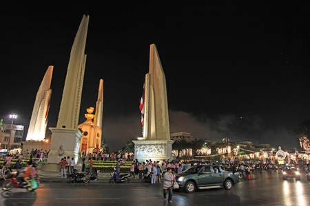 BANGKOK - DEC 5: Democracy Monument is decorated with flags on Ratchadamnoen Road for the Kings Birthday Celebration - Bangkok, Thailand 5th December 2010)