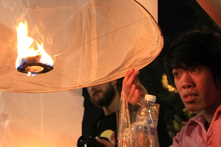 BANGKOK - DEC 5: People Holding a Burning Lantern at the King's Birthday Celebration - Bangkok, Thailand 5th December 2010) Stock Photo - 8449626