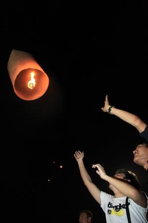 letting: BANGKOK - DEC 5: Letting go of a Burning Lantern at the Kings Birthday Celebration - Bangkok, Thailand 5th December 2010) Editorial