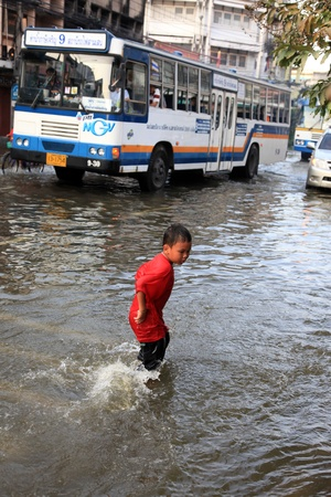 3 5 years: BANGKOK, THAILAND - NOVEMBER 17 : Flooding in Samsen Road after the heaviest rains in 20 years in Thailand on Nov 17, 2011 in Bangkok, Thailand Editorial