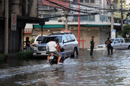 BANGKOK, THAILAND - NOVEMBER 17 : Flooding in Samsen Road after the heaviest rains in 20 years in Thailand on Nov 17, 2011 in Bangkok, Thailand Editorial
