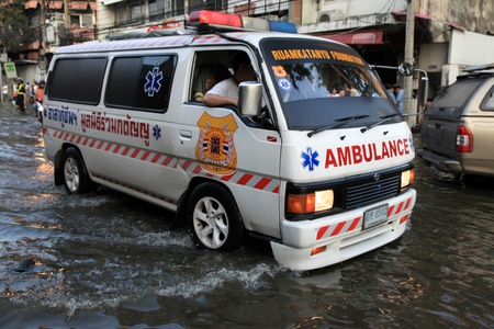 BANGKOK, THAILAND - NOVEMBER 17 : Ambulance rescue in floods after the heaviest rains in 20 years in Thailand on Nov 17, 2011 in Bangkok, Thailand Stock Photo - 11249827
