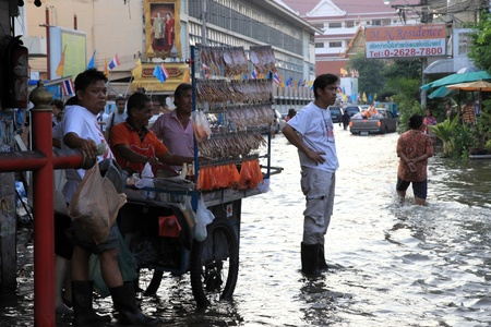 BANGKOK, THAILAND - NOVEMBER 17 : Flooding in Samsen Road after the heaviest rains in 20 years in Thailand on Nov 17, 2011 in Bangkok, Thailand Stock Photo - 11249849