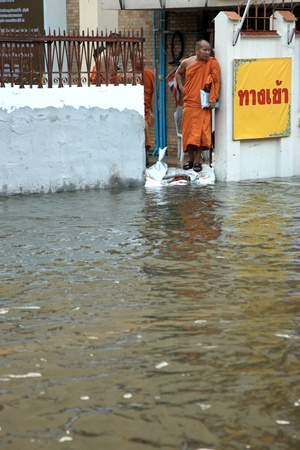 BANGKOK, THAILAND - NOVEMBER 17 : Buddhist Monks in floods after the heaviest rains in 20 years in Thailand on Nov 17, 2011 in Bangkok, Thailand
