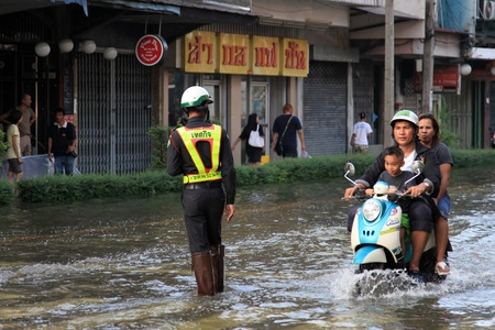 BANGKOK, THAILAND - NOVEMBER 17 : Motorbike navigates the floods after the heaviest rains in 20 years in Thailand on Nov 17, 2011 in Bangkok, Thailand Editorial