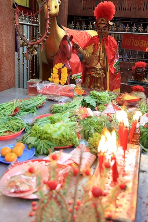 BANGKOK - JANUARY 23 : Chinese New Year 2012 - Offerings to the god in temple in Chinatown, Bangkok, Thailand