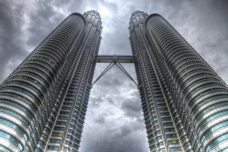 KUALA LUMPUR - NOV 26: The Petronas Twin Towers on November 26, 2011, in Kuala Lumpur, Malaysia are the world's tallest twin tower. The skyscraper height is 451.9m Editorial