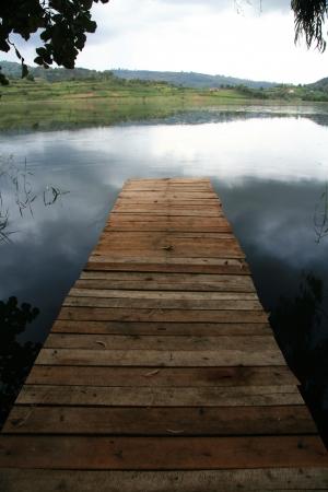 kisoro: Wooden Boat Harbour - Lake Bunyoni, Kisori District, Uganda in East Africa Stock Photo