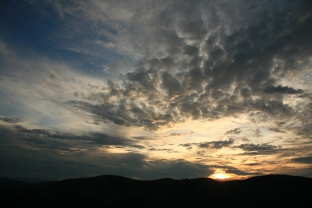 Sun Setting Over The Mountains in Uganda in East Africa photo