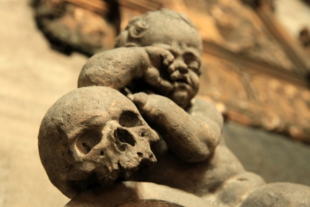 Baby and Skull Statue - Stephansdom (Saint Stephens Cathedral) - Vienna, Austria photo