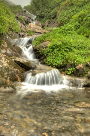 Fresh Waterfall from Mountain Spring, Alps photo